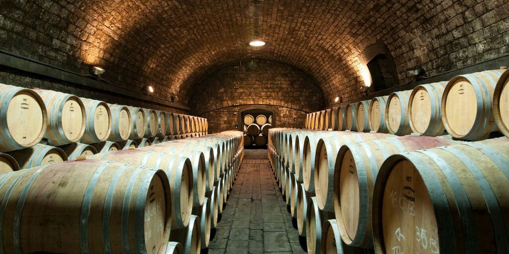 Antinori historical cellars under the Abbazia di Passignano, A former Benedictine order of Vallombrosa, was founded in 1049 by San Giovanni Gualberto and has the shape of a fortified monastery.
